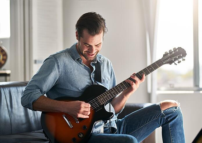man playing guitar_success in health